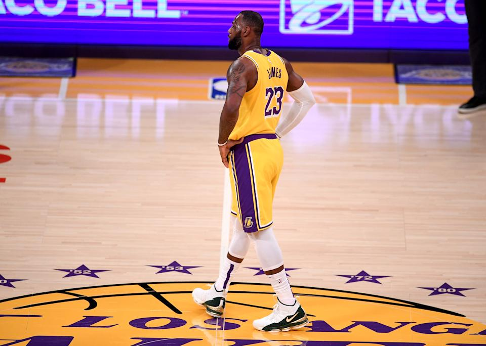 LeBron James walks across center court with his hands on his hips during Game 6.