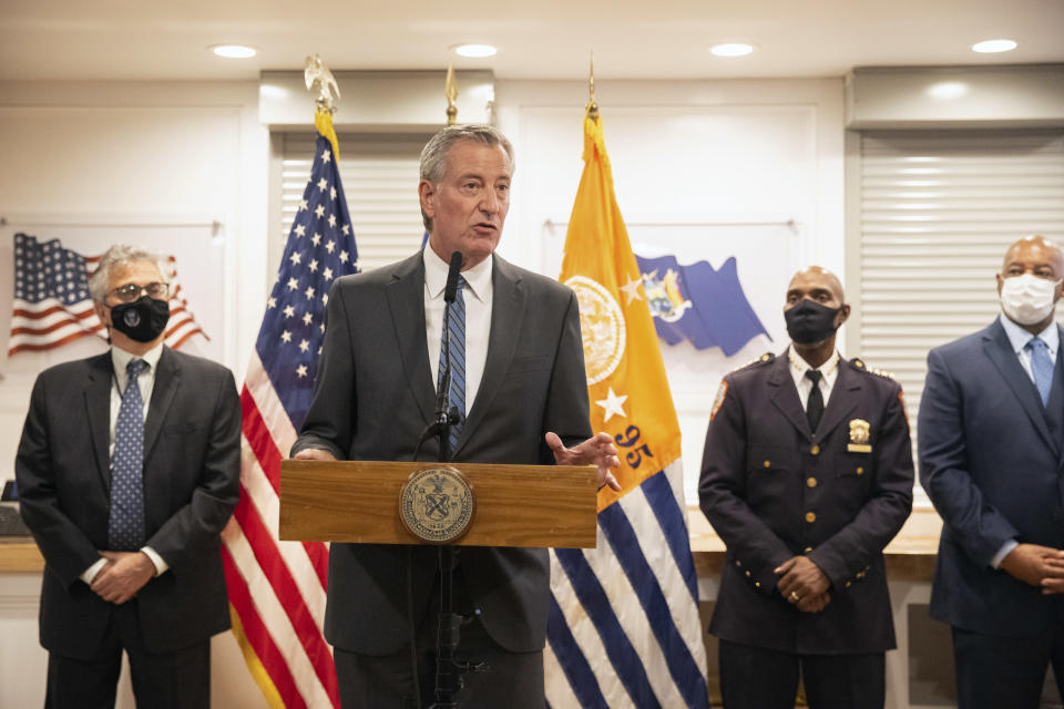 New York City Mayor Bill de Blasio speaks during a news conference at the Rikers Island correctional facility, Monday, Sept. 27, 2021, in New York. De Blasio visited Rikers Island after promising to observe the conditions at the beleaguered city jail complex. (AP Photo/Jeenah Moon)