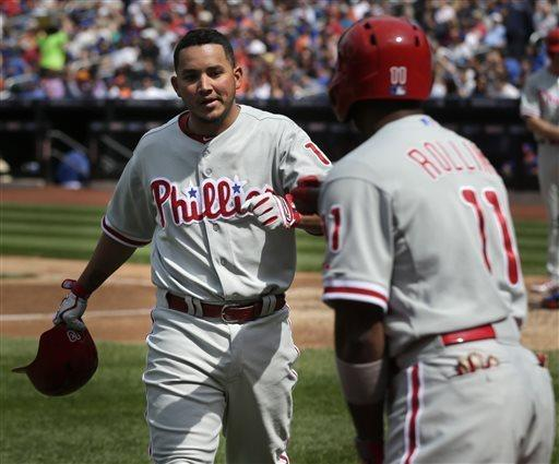 Philadelphia Phillies' Freddy Galvis, left, is greeted by teammate Jimmy Rollins after hitting a solo home run during the fifth inning of a baseball game against the New York Mets at Citi Field, Sunday, April 28, 2013, in New York. (AP Photo/Seth Wenig)