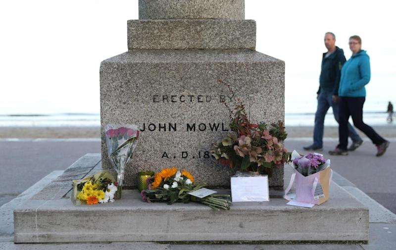 Tributes were laid by the seafront in Swanage (PA)