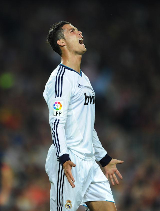 BARCELONA, SPAIN - OCTOBER 07: Cristiano Ronaldo of Real Madrid reacts during the la Liga match between FC Barcelona and Real Madrid at the Camp Nou stadium on October 7, 2012 in Barcelona, Spain. (Photo by Jasper Juinen/Getty Images)
