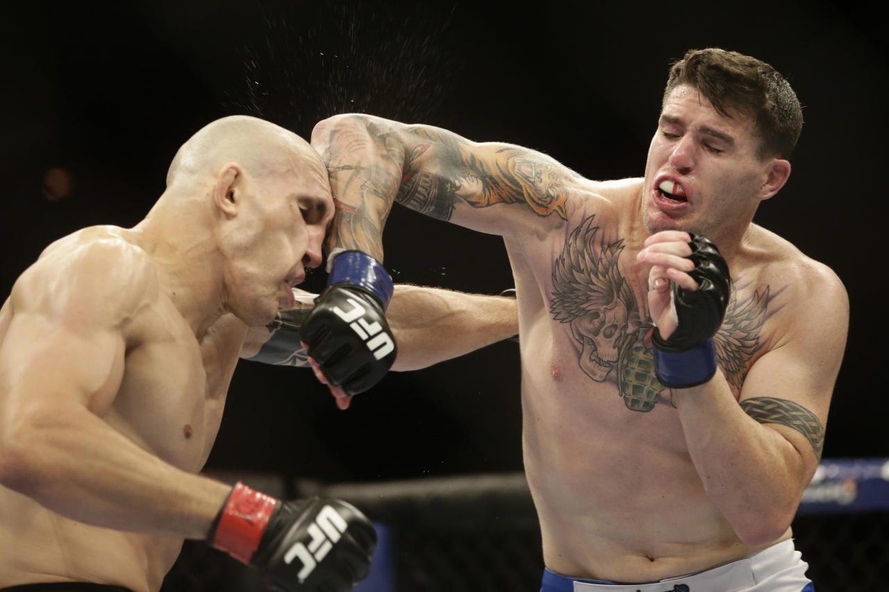 Luiz Cane, from Brazil, left, fights Chris Camozzi, from the U.S, during their middleweight mixed martial arts bout at the Ultimate Fighting Championship (UFC) 153 in Rio de Janeiro, Brazil, Saturday Oct. 13, 2012. Camozzi defeated Cane. (AP Photo/Felipe Dana)