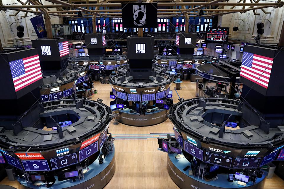 The floor of the New York Stock Exchange (NYSE) stands empty as the building prepares to close indefinitely due to the coronavirus disease (COVID-19) outbreak in New York, U.S., March 20, 2020.  REUTERS/Lucas Jackson