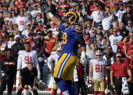 FILE PHOTO - Dec 30, 2018; Los Angeles, CA, USA; Los Angeles Rams defensive end Aaron Donald (99) celebrates after a sack in the first quarter against the San Francisco 49ers at Los Angeles Memorial Coliseum. Mandatory Credit: Kirby Lee-USA TODAY Sports