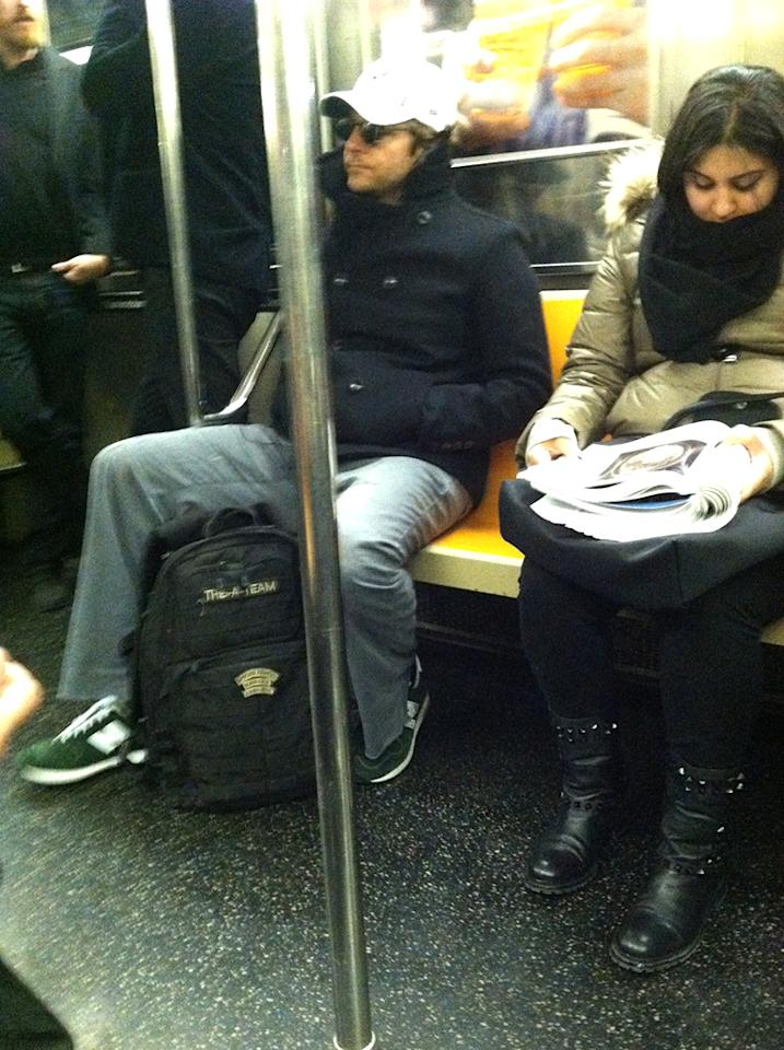 There are many New York couples who met via love-at-first-sight on the subway ... and many ladies who wish that would happen with them an this passenger ... Bradley Cooper. Girl with the magazine, look to your right! (11/17/2012)