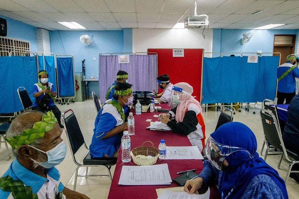 People from the Orang Asli community receive the first dose of the Covid-19 vaccine in Gombak June 19, 2021. ― Picture by Firdaus Latif