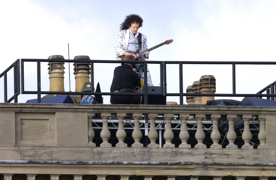 LONDON, UNITED KINGDOM - JUNE 02:  The National Anthem Played By Guitarist Brian May From The Roof Of The Palace During
