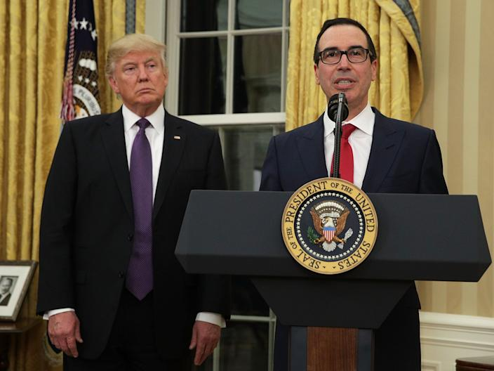 Steven Mnuchin and President Donald Trump in the Oval Office of the White House February 13, 2017 in Washington, DC.