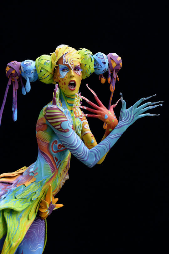 <p>A participant poses with her bodypainting designed by bodypainting artist Carugati Benedetta from Italy. (Source: Didier Messens/Redferns via Getty Images)</p>