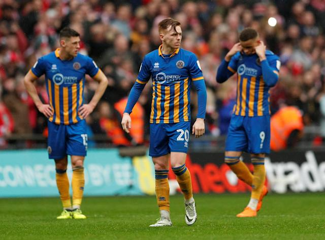 "Soccer Football - Checkatrade Trophy Final - Lincoln City vs Shrewsbury Town - Wembley Stadium, London, Britain - April 8, 2018 Shrewsbury Town's James Bolton, Shrewsbury Town's Jon Nolan and Shrewsbury Town's Carlton Morris look dejected at the final whistle Action Images/Andrew Boyers EDITORIAL USE ONLY. No use with unauthorized audio, video, data, fixture lists, club/league logos or ""live"" services. Online in-match use limited to 75 images, no video emulation. No use in betting, games or single club/league/player publications. Please contact your account representative for further details."