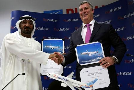 Flydubai and Emirates Chairman Sheikh Ahmed bin Saeed al-Maktoum shakes hands with Boeing Commercial Airplanes President & Chief Executive Kevin McAllister during a news conference at the Dubai Airshow in Dubai