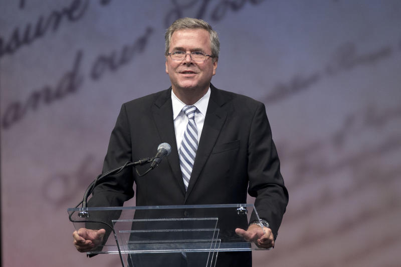 Former Florida Gov. Jeb Bush speaks ahead of Former Secretary of State Hillary Rodham Clinton receiving the Liberty Medal during a ceremony at the National Constitution Center, Tuesday, Sept. 10, 2013, in Philadelphia. The honor is given annually to an individual who displays courage and conviction while striving to secure liberty for people worldwide. (AP Photo/Matt Rourke)