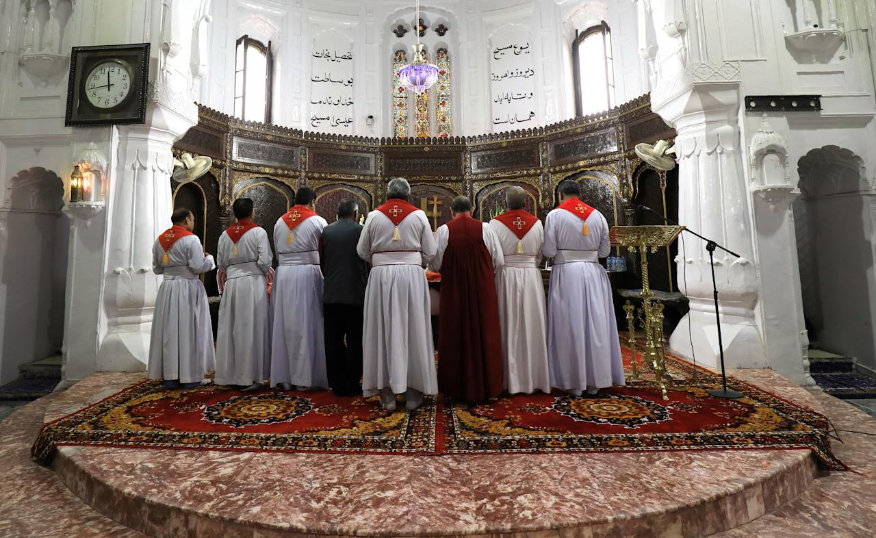 Pakistani priests hold a moment of silence to pay respects to the victims of Sri Lanka's serial bomb blasts, at the All Saints Church in Peshawar, Pakistan April 24, 2019. REUTERS/Fayaz Aziz