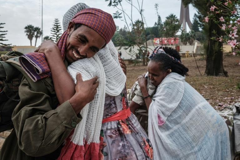 Women in the Tigrayan capital Mekele welcome the returning members of the Tigray Defence Force (TDF)