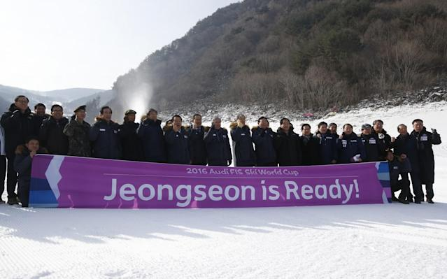 <p>South Korean members of the PyeongChang 2018 Winter Olympics Organizing Committee and government officers cheer with a banner for the upcoming official Test Event of the Pyeongchang 2018 Winter Olympics at the Jeongseon Alpine Centre in Jeongseon, South Korea. </p>