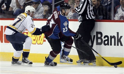 Colorado Avalanche right winger Milan Hejduk, right, of the Czech Republic, picks up the puck along the boards as Nashville Predators right winger Patric Hornqvist, of Sweden, covers in the second period of an NHL hockey game in Denver, Saturday, April 7, 2012. (AP Photo/David Zalubowski)