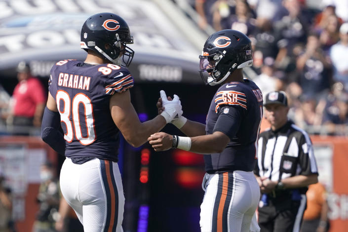 Chicago Bears tight end Jimmy Graham (80) celebrates with quarterback Justin Fields the team's 20-17 win over the Cincinnati Bengals after an NFL football game Sunday, Sept. 19, 2021, in Chicago. (AP Photo/David Banks)