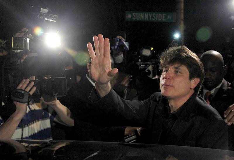 Former Illinois Gov. Rod Blagojevich departs his Chicago home for Littleton, Colo., to begin his 14-year prison sentence on corruption charges Thursday, March 15, 2012. The 55-year-old Democrat becomes the second Illinois governor in a row to go to prison for corruption. (AP Photo/Charles Rex Arbogast)
