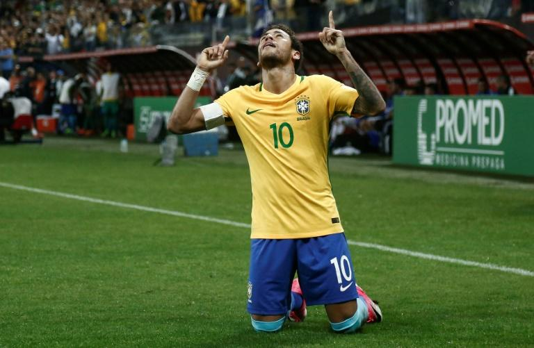 Brazil's Neymar celebrates after scoring against Paraguay during their Russia 2018 World Cup qualifier match, in Sao Paulo, on March 28, 2017