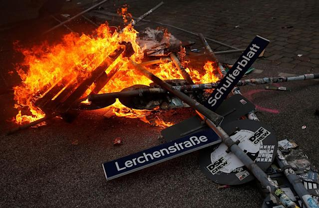 <p>A road sign is on fire during a protest on July 7, 2017 in Hamburg, northern Germany, where leaders of the world's top economies gather for a G20 summit. (Photo: Ronny Hartmann/AFP/Getty Images) </p>