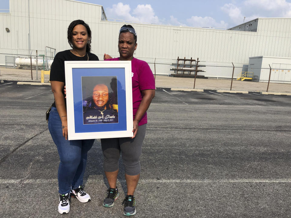 Cousins of Malik Parks, Shaunice Cherry, left, and Machelle Tompkins pose for a photo on Tuesday, July 20, 2021, in Indianapolis. Homicide rates in many American cities have continued to rise although not as precipitously as the double-digit jumps seen in 2020 and still below the violence of the mid-90s. (AP Photo/Casey Smith)