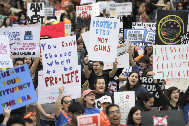 <p>Demonstrators cheer during a March for Our Lives protest for gun legislation and school safety in Houston, Texas. (AP Photo/David J. Phillip) </p>