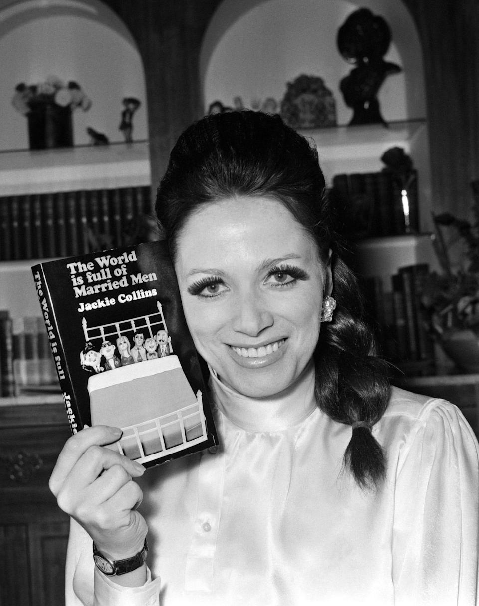 """In this Feb. 12, 1968 file photo, author Jackie Collins holds her first book, """"The World Is Full Of Married Men,"""" at her apartment in London. The author is the subject of the new documentary """"Lady Boss,"""" premiering June 10 at the Tribeca Film Festival."""