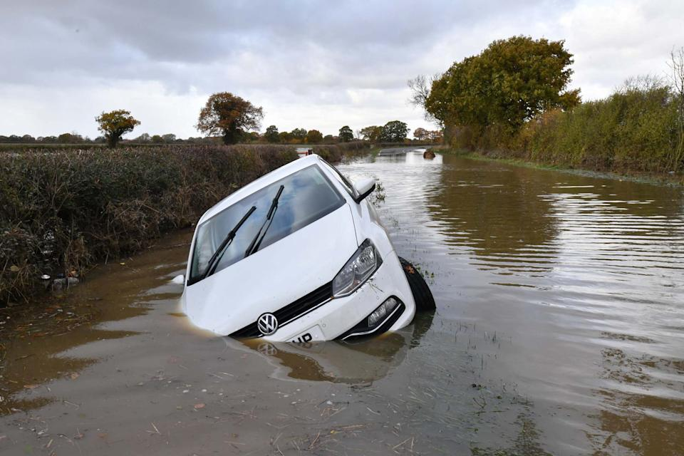 A car sits in flood water in the town of Fishlake near Doncaster after the river Don burst its banks on November 11 (Getty Images)