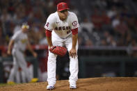 Los Angeles Angels relief pitcher Jose Quintana reacts after a throwing error on a pickoff attempt to first base resulting in a run scored by Oakland Athletics' Elvis Andrus during the seventh inning of a baseball game in Anaheim, Calif., Thursday, July 29, 2021. (AP Photo/Kelvin Kuo)