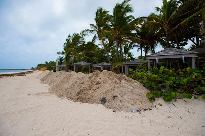 A sand seawall is placed in front of the hotel KKO, as part of preparations for arrival of Hurricane Irma on the beach in Orient Bay, on the French overseas island of Saint-Martin.