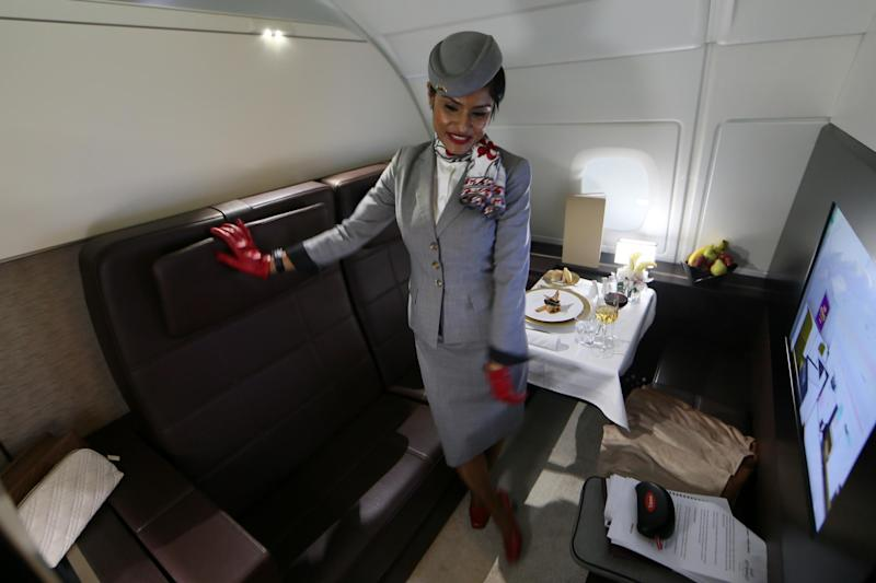Cabin crew, like this Etihad flight attendant (not our interviewee), have to keep smiling (Getty)