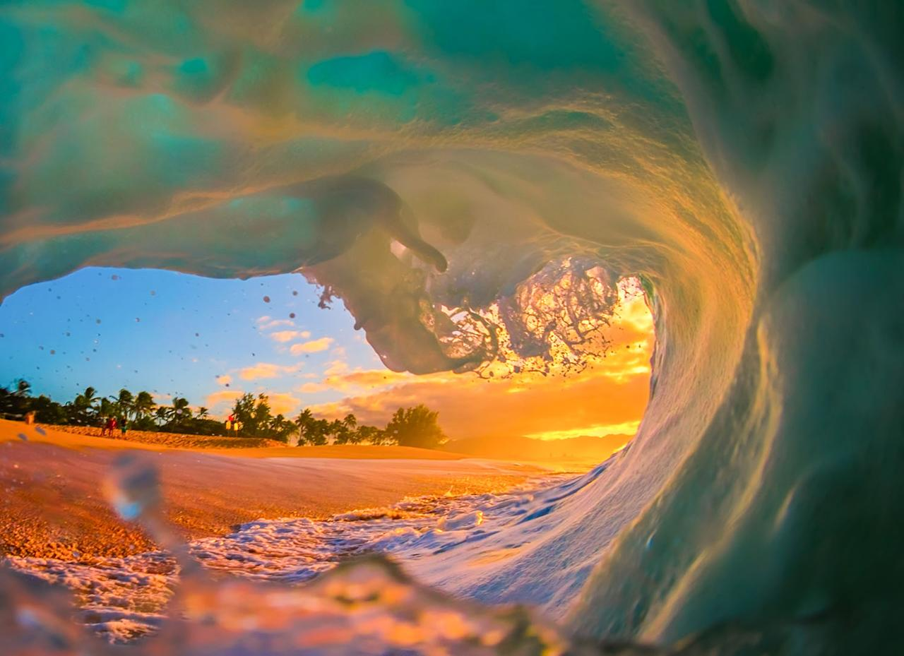 "<p>Photographer Marco Mitre, 39, said: ""The water is very warm in Hawaii, so I can get away with a pair of board shorts and a rash guard in the water. During bigger waves, swim fins are a necessity to help fight through the water."" (Photo: Marco Mitre/Caters News) </p>"