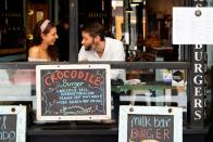 People dine at a cafe after coronavirus disease restrictions were eased in Melbourne