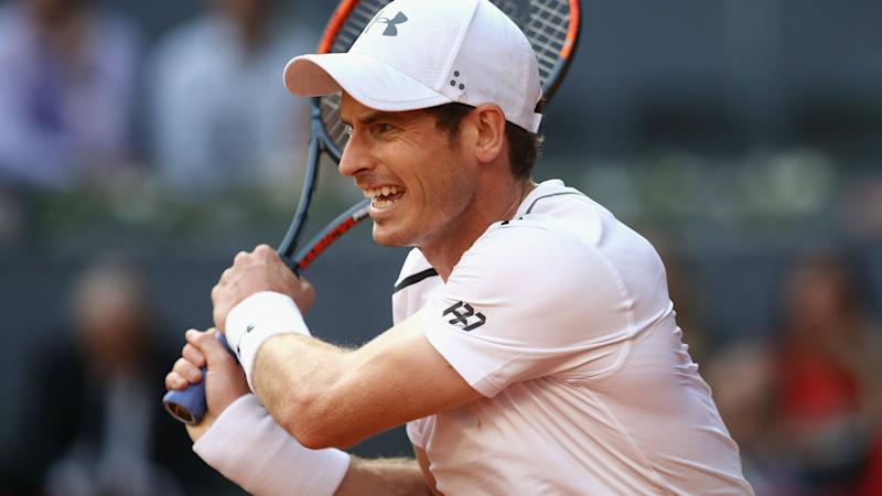 Murray makes Madrid last 16, Pouille bows out