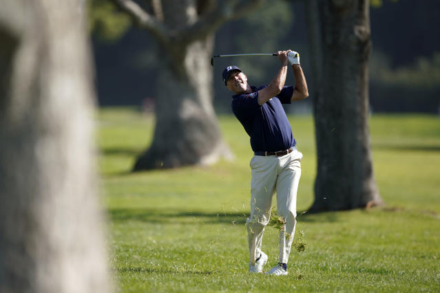 Matt Kuchar hits his second shot from the rough on the second hole during the third round of the Genesis Invitational golf tournament at Riviera Country Club, Saturday, Feb. 15, 2020, in the Pacific Palisades area of Los Angeles. (AP Photo/Ryan Kang)