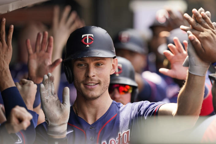 Minnesota Twins' Max Kepler is congratulated by teammates after hitting a three-run home run in the fourth inning of a baseball game against the Cleveland Indians, Sunday, May 23, 2021, in Cleveland. (AP Photo/Tony Dejak)