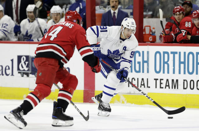Carolina Hurricanes' Justin Williams (14) defends against Toronto Maple Leafs' John Tavares (91) during the first period of an NHL hockey game in Raleigh, N.C., Wednesday, Nov. 21, 2018. (AP Photo/Gerry Broome)