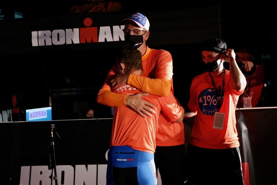 Chris Nikic hug from dad Nik at ironman finish line