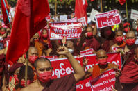 Buddhist monks lead a protest march against the military coup in Mandalay, Myanmar on Wednesday, Feb. 10, 2021. Protesters continued to gather Wednesday morning in Mandalay breaching Myanmar's new military rulers' decrees that effectively banned peaceful public protests in the country's two biggest cities. (AP Photo)
