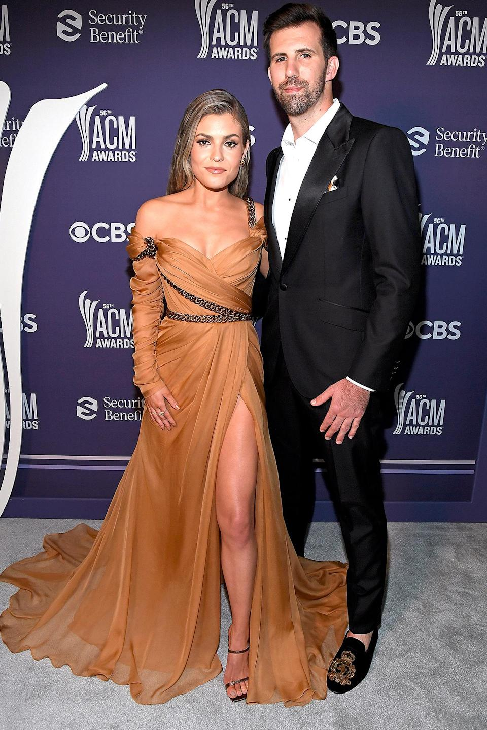 "<p>Canadian country singer Arts was excited to attend her first-ever ACM Awards with her love. ""I can't even handle getting to wear this dress,"" <a href=""https://www.instagram.com/p/CN0piSrnhSw/"" rel=""nofollow noopener"" target=""_blank"" data-ylk=""slk:she wrote on Instagram"" class=""link rapid-noclick-resp"">she wrote on Instagram</a> of her custom Dolce & Gabbana gown. </p>"