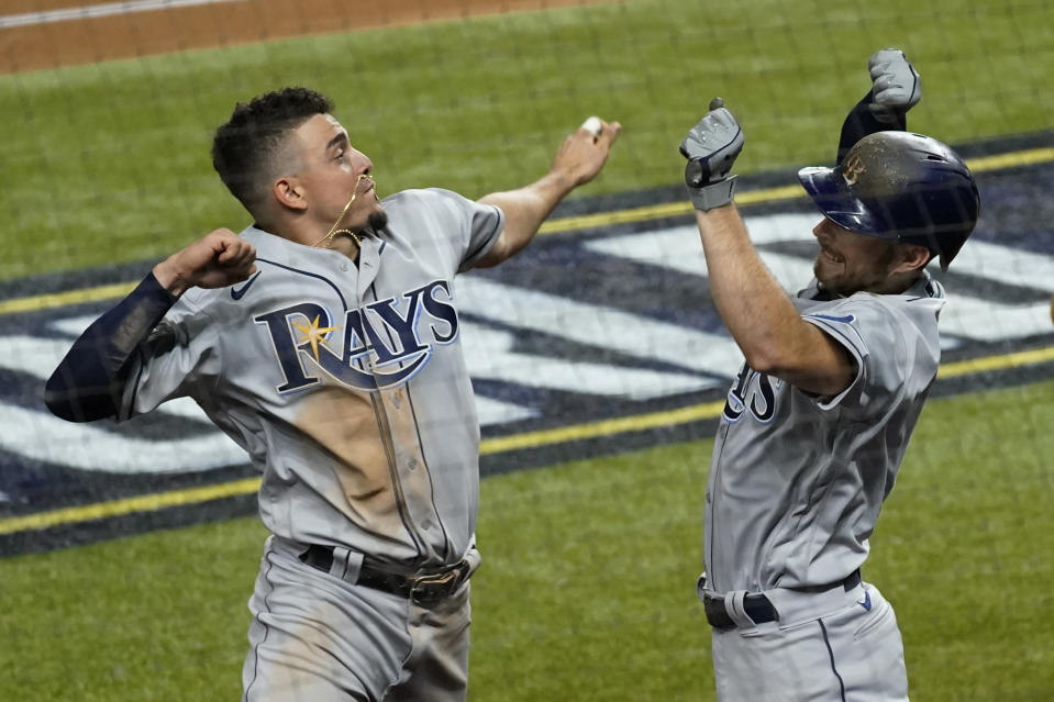 Tampa Bay Rays' Brandon Lowe, right, celebrates his a two-run home run with Willy Adames against the Los Angeles Dodgers during the fifth inning in Game 2 of the baseball World Series Wednesday, Oct. 21, 2020, in Arlington, Texas. (AP Photo/Tony Gutierrez)