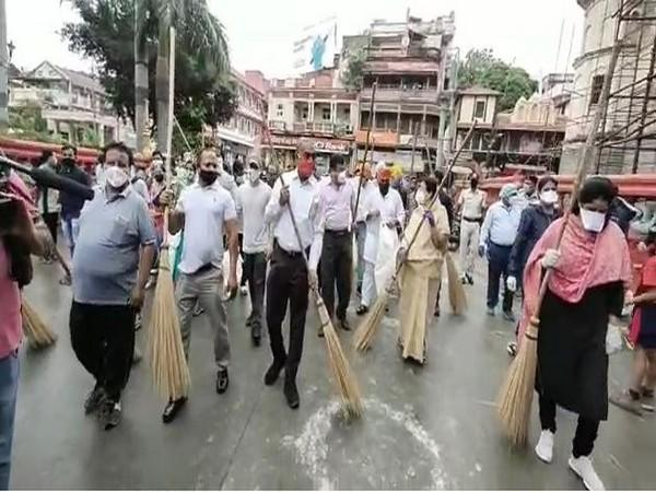 Locals participate in cleanliness drive in Indore (Photo/ANI)