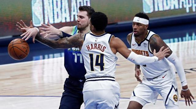 Denver Nuggets player Gary Harris (R) knocks the ball loose against Dallas Mavericks player Luka Doncic (L) of Slovenia during the NBA basketball game between the Denver Nuggets and the Dallas Mavericks at the American Airlines Center in Dallas, Texas, USA, 08 January 2020. EFE/EPA/LARRY W. SMITH