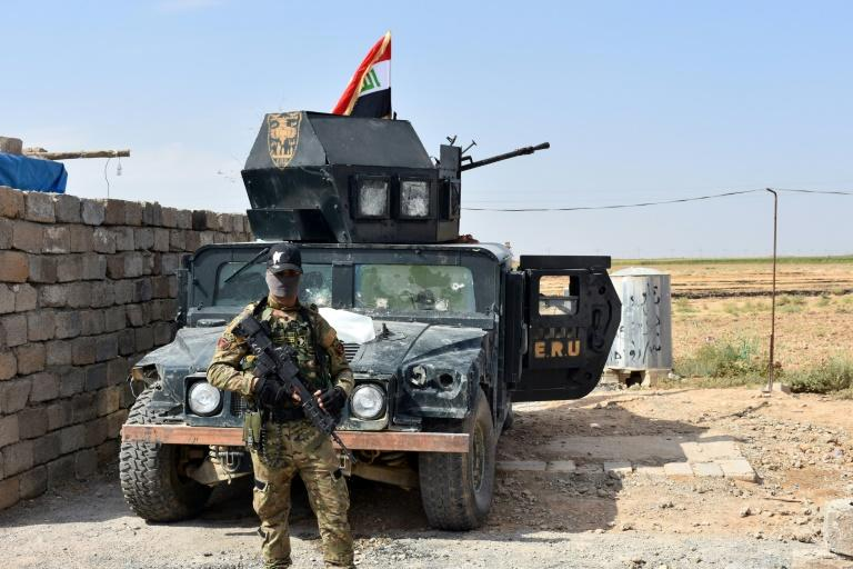 Iraqi troops guard a military position retaken from Kurdish forces in the Kirkuk province town of Taza Khurmatu on October 13, 2017