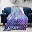 <p>Stay cozy with this <span>King Dare Mermaid Scales with Galaxy Fleece Sofa Blanket</span> ($22).</p>