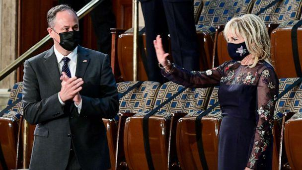 PHOTO: First Lady Jill Biden waves next to Second Gentleman Doug Emhoff as they greet the arrival President Joe Biden to address a joint session of Congress at the Capitol, April 28, 2021. (Jim Watson/Pool via Reuters)