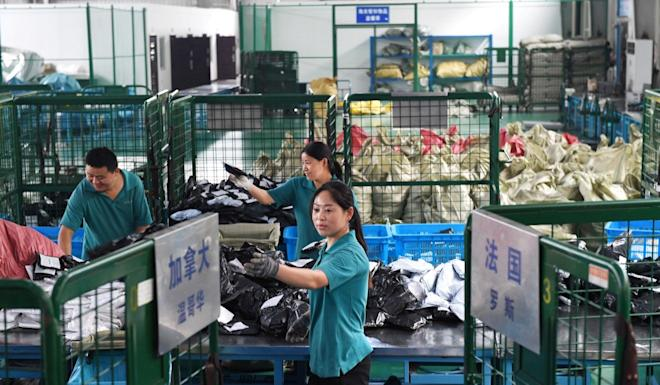 Workers sort international parcels at a cross-border e-commerce industrial park ahead of the Singles Day online shopping festival in Hefei, Anhui province, China. Photo: Reuters