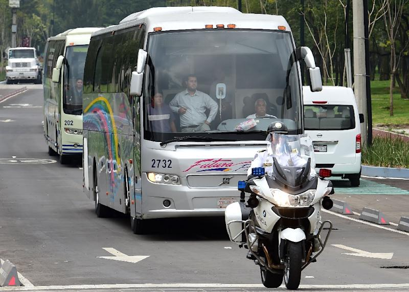 Relatives of the 43 missing students from Ayotzinapa arrive in a bus to a private meeting with Mexican President Enrique Pena Nieto, in Mexico City, on September 24, 2015 (AFP Photo/Ronaldo Schemidt)