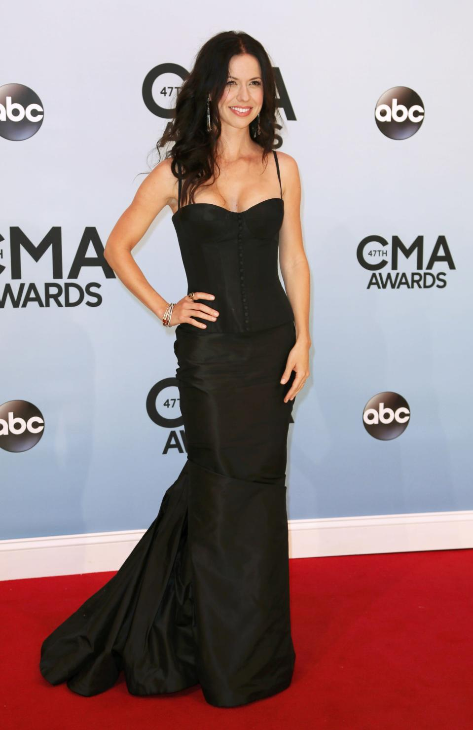 Joy Williams poses on arrival at the 47th Country Music Association Awards in Nashville, Tennessee November 6, 2013. REUTERS/Eric Henderson (UNITED STATES - Tags: ENTERTAINMENT)