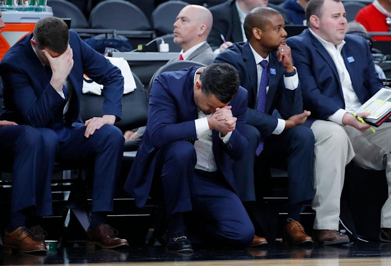 Arizona's head coach Sean Miller, center, reacts after a play against Southern California during the second half of an NCAA college basketball game in the first round of the Pac-12 men's tournament Wednesday, March 13, 2019, in Las Vegas. (AP Photo/John Locher)